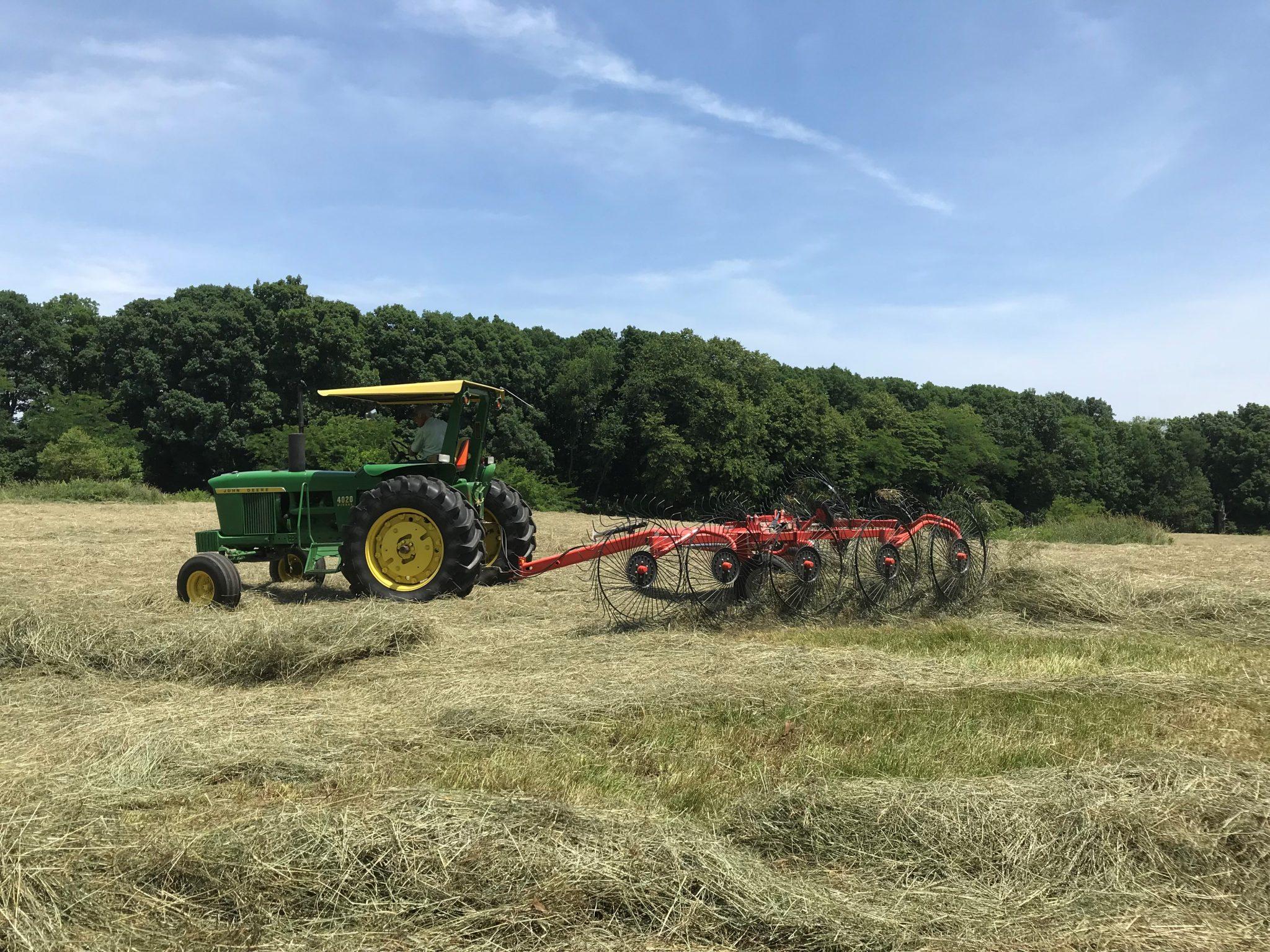 Raking hay into a windrow before baling occurs. (Photo Credit: Keith Johnson)