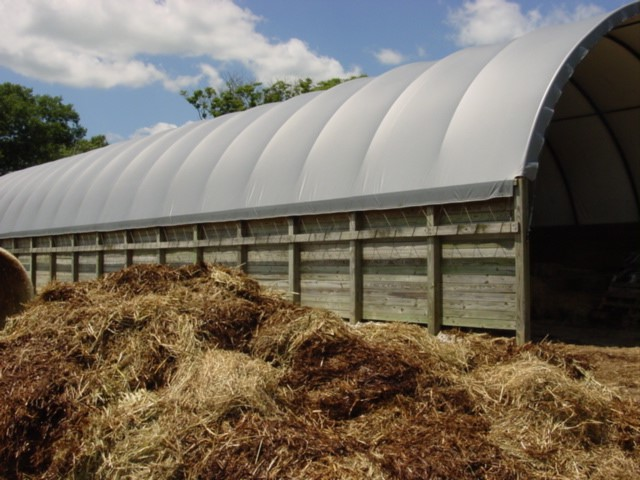 Hay in the foreground was removed from the hoop building because it was smoldering. (Photo Credit: Keith Johnson)