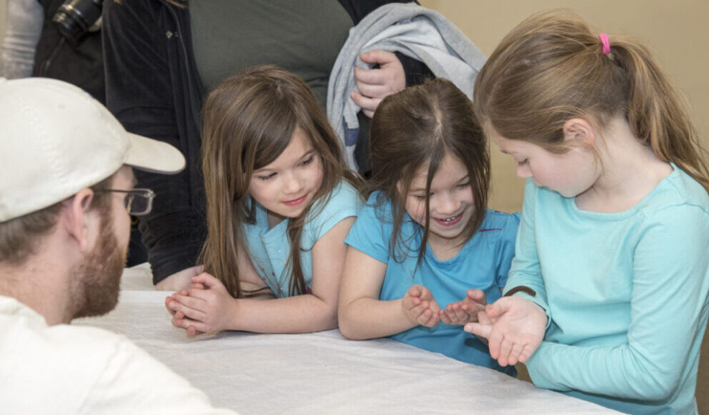 three girls with a millipede